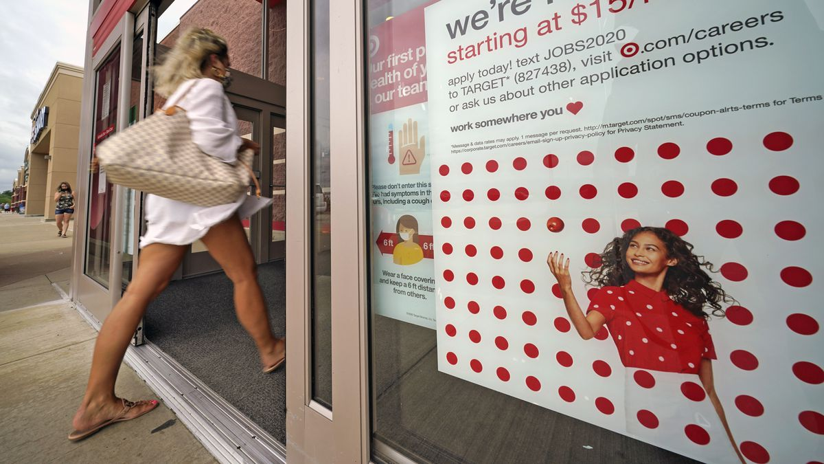 In this Sept. 2, 2020, file photo, a help wanted sign hangs on the door of a Target store in Uniontown, Pa. The government issues the jobs report Friday, Sept. 4, for August at a time of continuing layoffs and high unemployment.