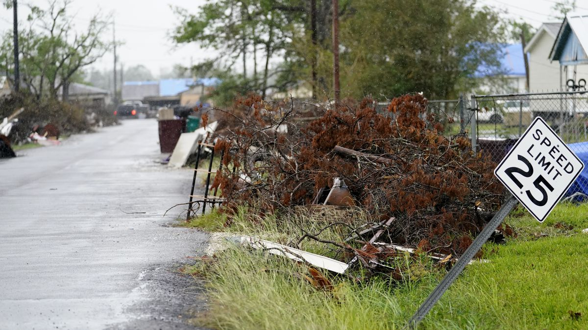 A neighbored that was hit by Hurricane Laura is seen ahead of Hurricane Delta, Friday, Oct. 9, 2020, in Lake Charles, La. Forecasters said Delta — the 25th named storm of an unprecedented Atlantic hurricane season — would likely crash ashore Friday evening somewhere on southwest Louisiana's coast. (AP Photo/Gerald Herbrt)