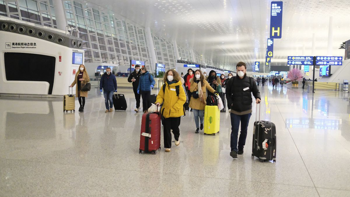 People wear face masks as they walk through the terminal at Wuhan Tianhe International Airport as they prepare to board an evacuation flight for EU nationals in Wuhan in central China's Hubei Province, late Saturday, Feb. 1, 2020. China's death toll from a new virus has increased to 304 with more than 14,000 cases, amid warnings from the World Health Organization that other countries need to be prepared in the event the disease spreads among their populations. (AP Photo/Arek Rataj)