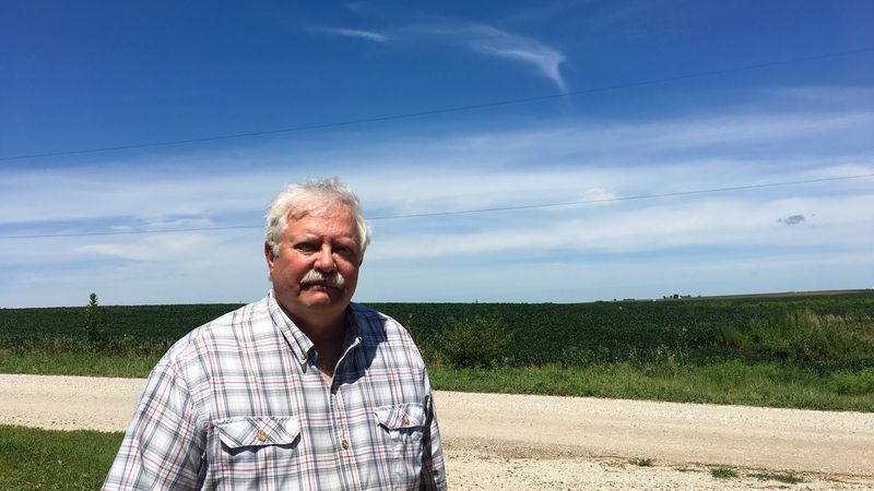 Dr. Michael Rosmann stands on his farm in Harlan, Iowa. (Source: Gray DC)
