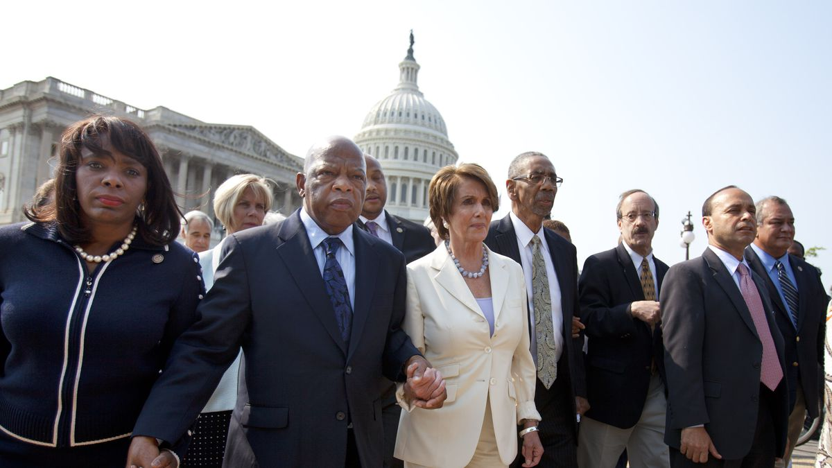 From left, Rep. Terri Sewell, D-Ala.,  Rep. John Lewis, D-Ga., House Minority Leader Nancy Pelosi of Calif., Rep. Bobby Rush, D-Ill., Rep. Eliot Engel, D-N.Y., Rep. Luis Gutierrez, D-Ill., and other House Democrats leave Capitol Hill in Washington, Thursday, June 28, 2012, in protest of a House vote holding Attorney General Eric Holder in contempt of Congress.