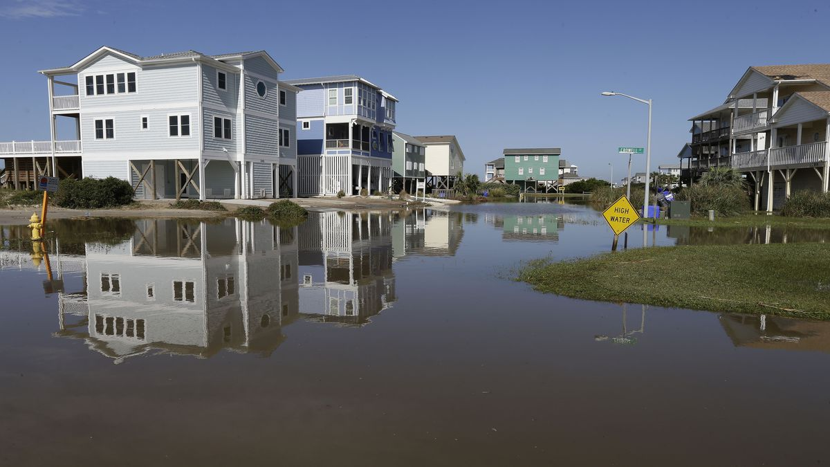 Flooded roadways in Ocean Drive are seen following the effects of Hurricane Isaias in Caswell Beach, N.C., Tuesday, Aug. 4, 2020. (AP Photo/Gerry Broome)