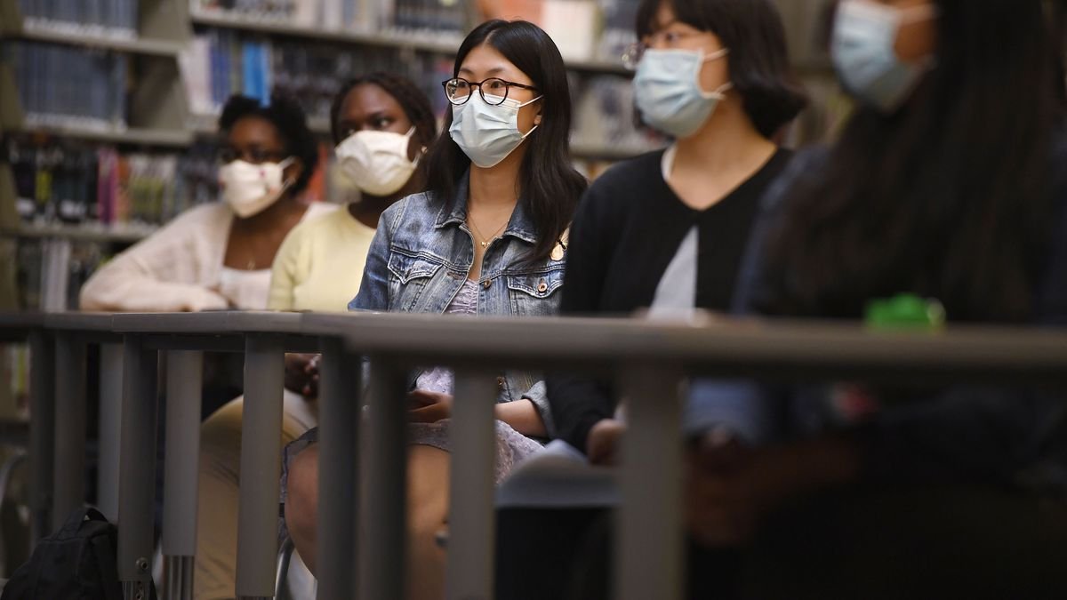 In this Monday, May 10, 2021, photo, Senior Annie Chen, center, listens with classmates as...