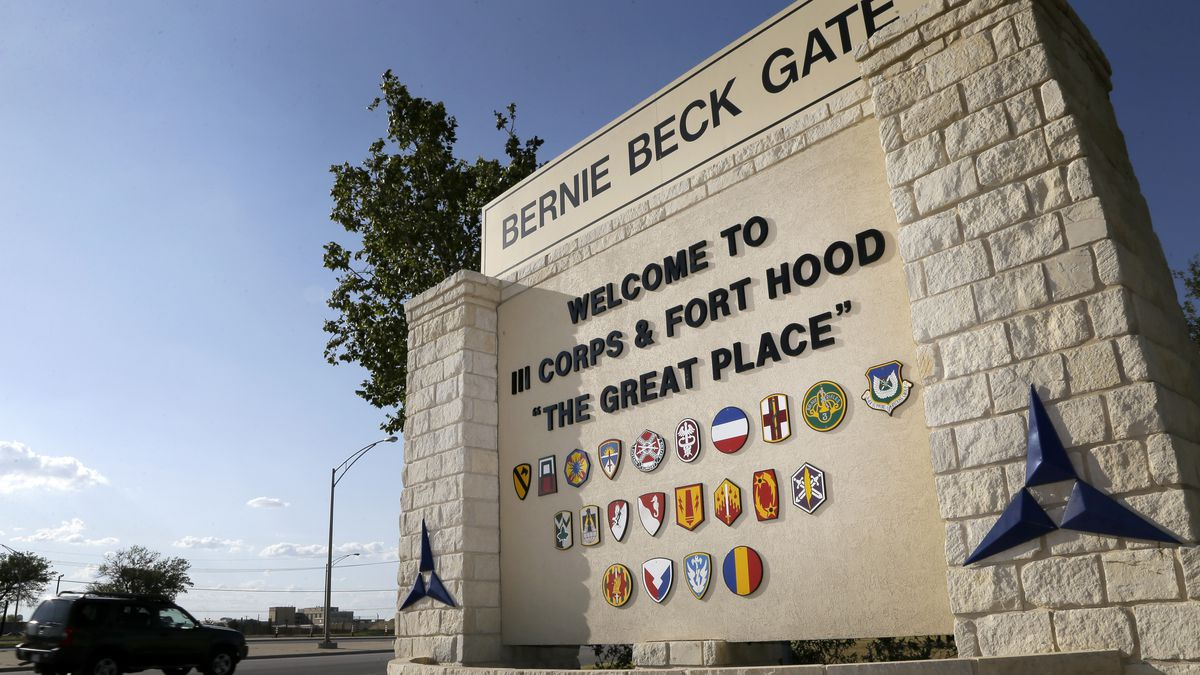 Traffic flows through the main gate past a welcome sign, Tuesday, July 9, 2013, in Fort Hood, Texas.