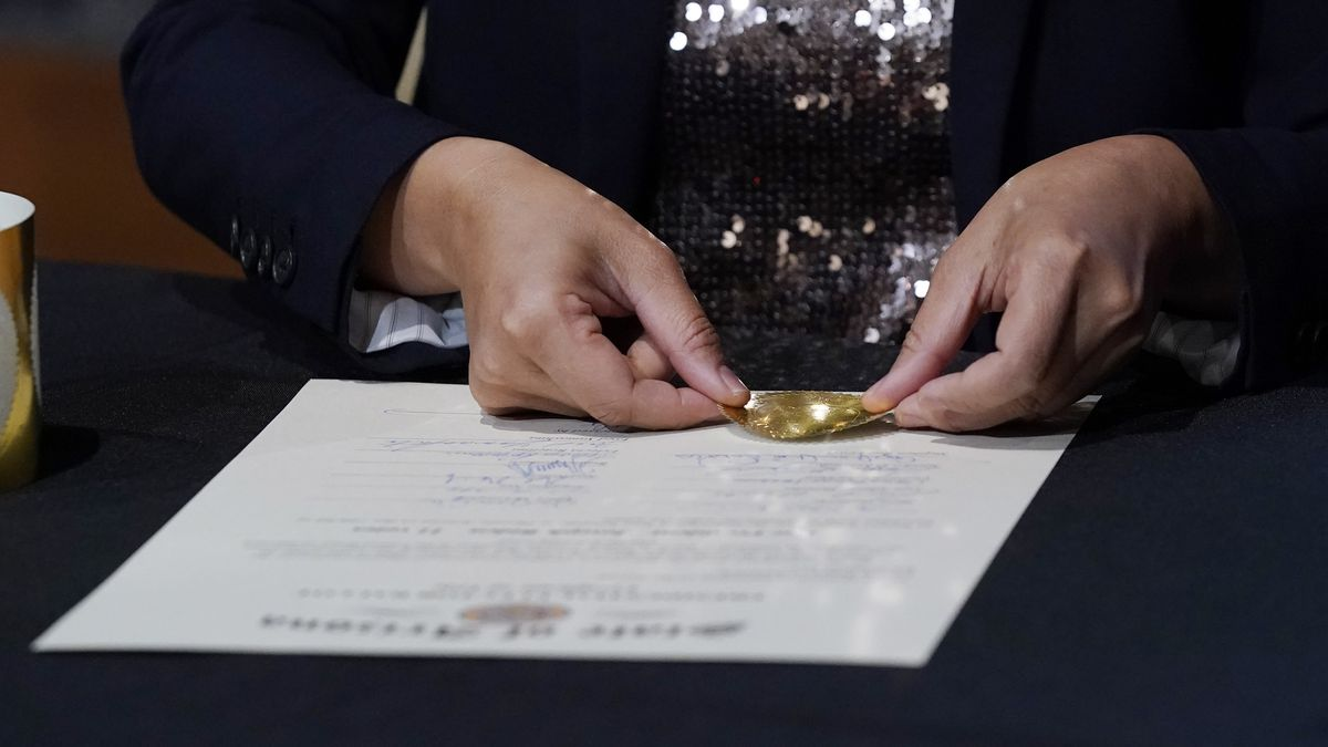 Arizona Election Services Director Bo Dul puts the official seal on the Arizona Presidential...