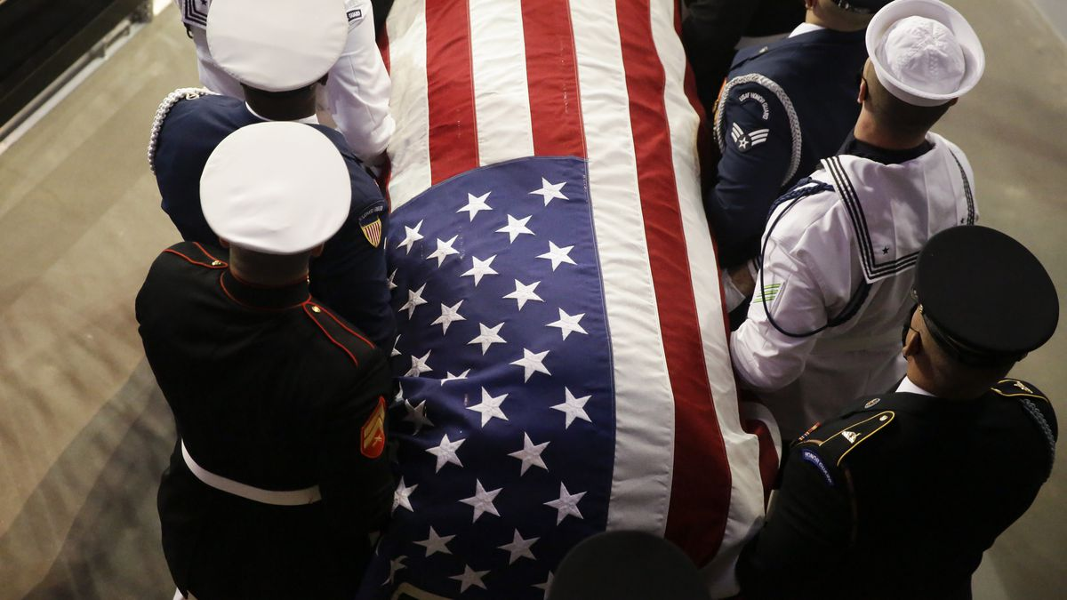 The casket of the late Rep. John Lewis, D-Ga., arrives to lie in repose at Troy University on Saturday, July 25, 2020, in Troy, Ala.