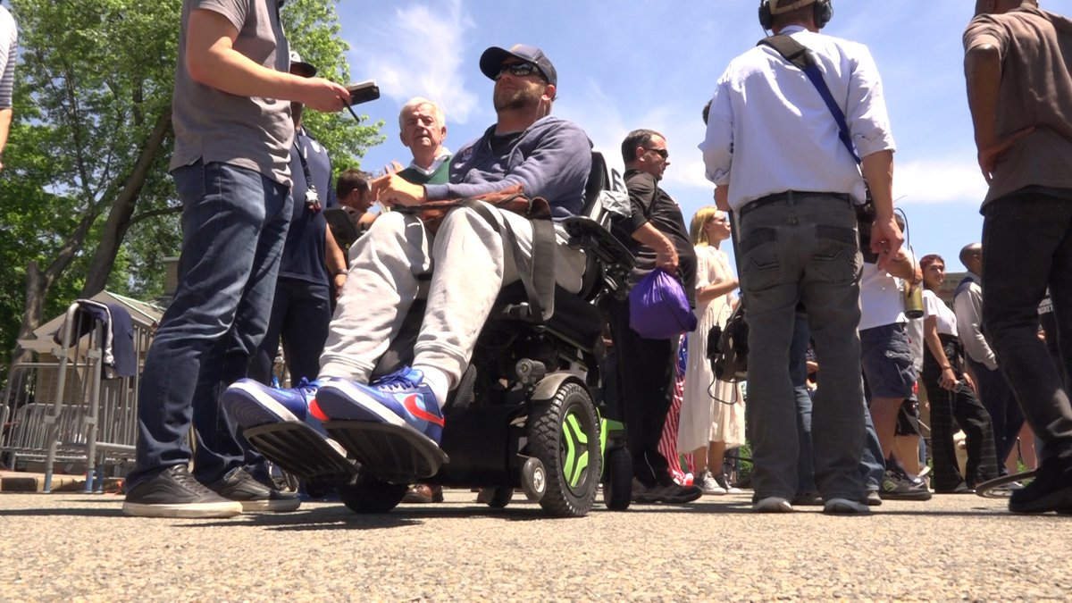 Janne Kouri rode his wheelchair through the finish line at Georgetown University, after...