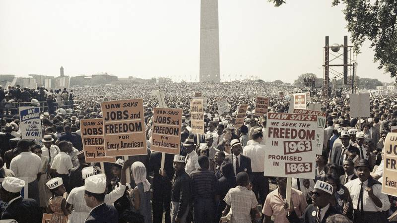 Large crowds gather at the Lincoln Memorial to demonstrate for the civil rights movement in...