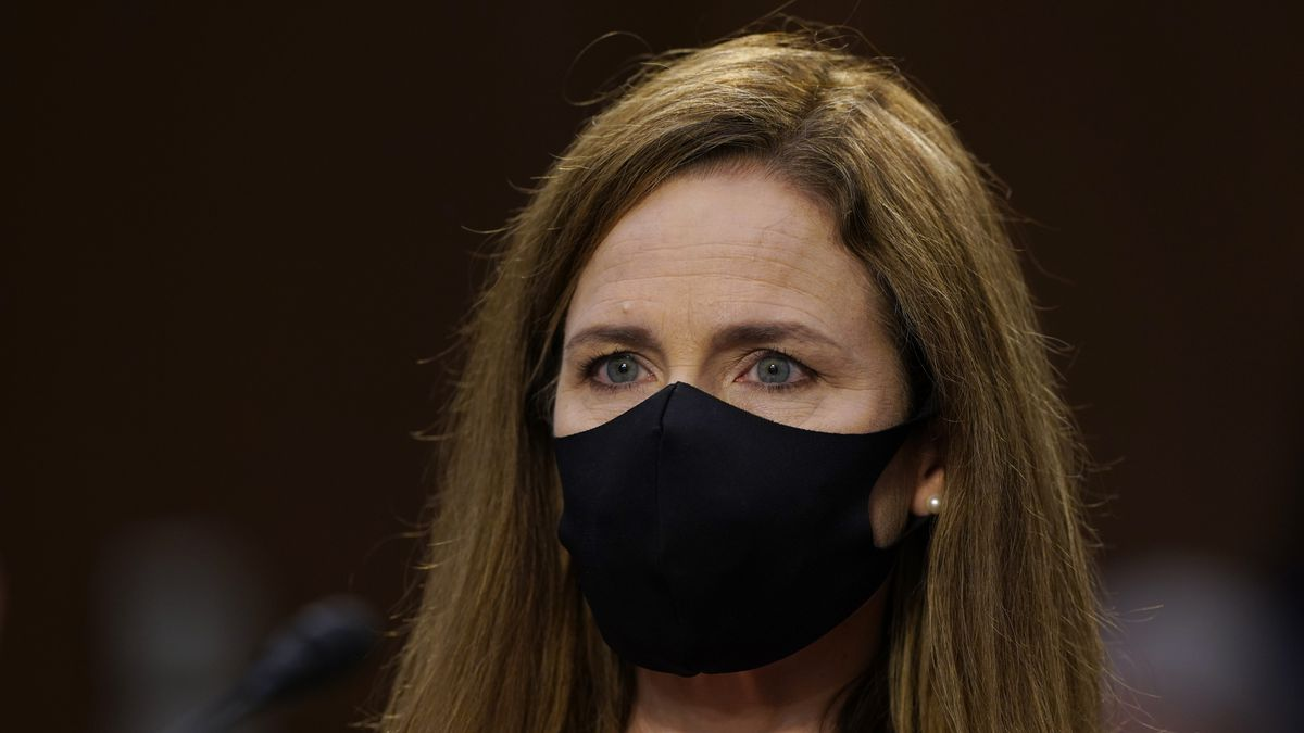 Supreme Court nominee Amy Coney Barrett arrives for her confirmation hearing before the Senate...