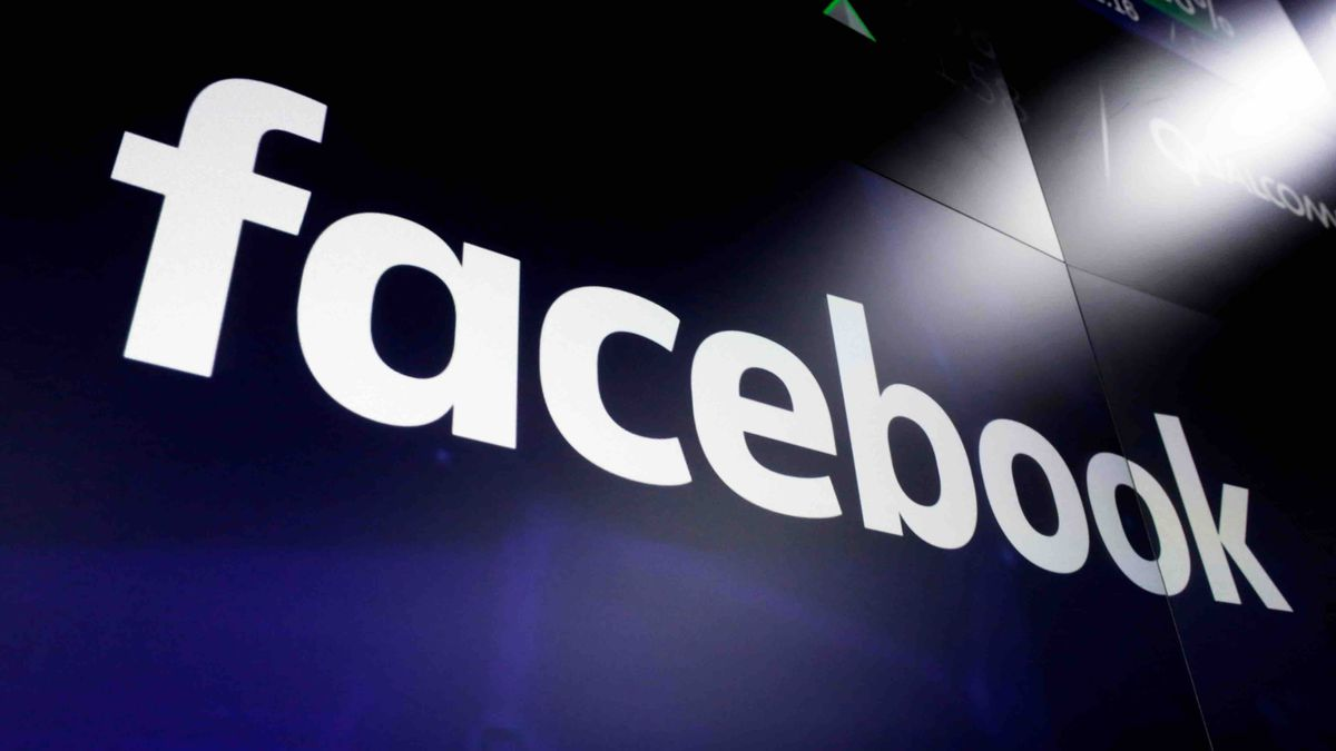 FILE - In this file photo dated March 29, 2018,  the logo for social media giant Facebook, appears on screens at the Nasdaq MarketSite, in New York's Times Square. The British Parliament's media committee seized confidential Facebook documents from a developer and on Wednesday Dec. 5, 2018, has released a cache of documents that show Facebook considered charging developers for data access. (AP Photo/Richard Drew, FILE)