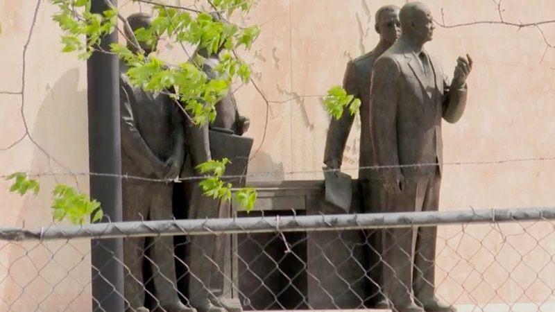 A chain-link fence surrounds the newly completed Dwight Eisenhower Memorial in Washington, D.C....