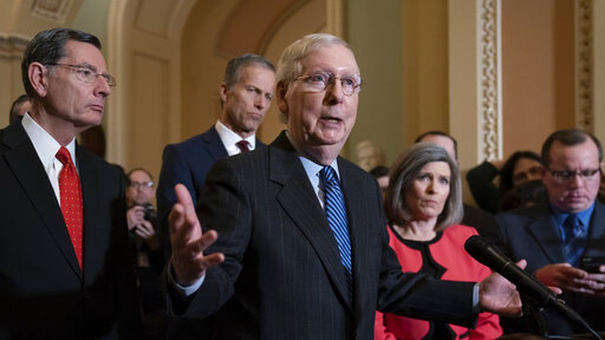 Senate Majority Leader Mitch McConnell, R-Ky., joined from left by Sen. John Barrasso, R-Wyo., Majority Whip John Thune, R-S.D., and Sen. Joni Ernst, R-Iowa, tells reporters he has secured enough Republican votes to start President Donald Trump's impeachment trial and postpone a decision on witnesses and documents Democrats want, at the Capitol in Washington, Tuesday Jan. 7, 2020. The trial could start as soon as this week if House Speaker Nancy Pelosi releases the articles of impeachment. (AP Photo/J. Scott Applewhite)