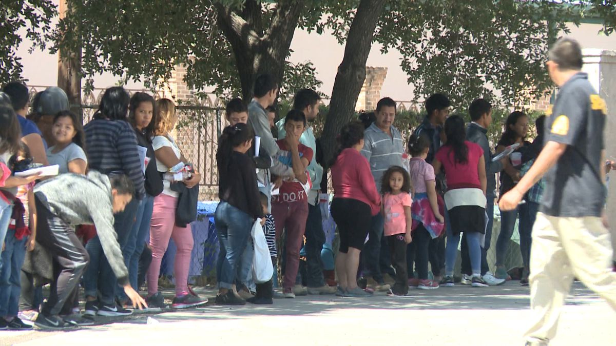 Migrants line up outside of Catholic Charities at the Diocese of Laredo this week.  (Source: KGNS)