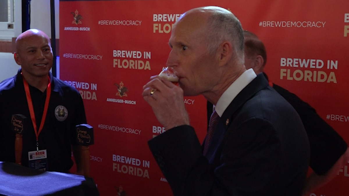 Senator Rick Scott (R-FL) sips on his Orange Blossom Ale brewed in Jacksonville. (Source: Gray DC)