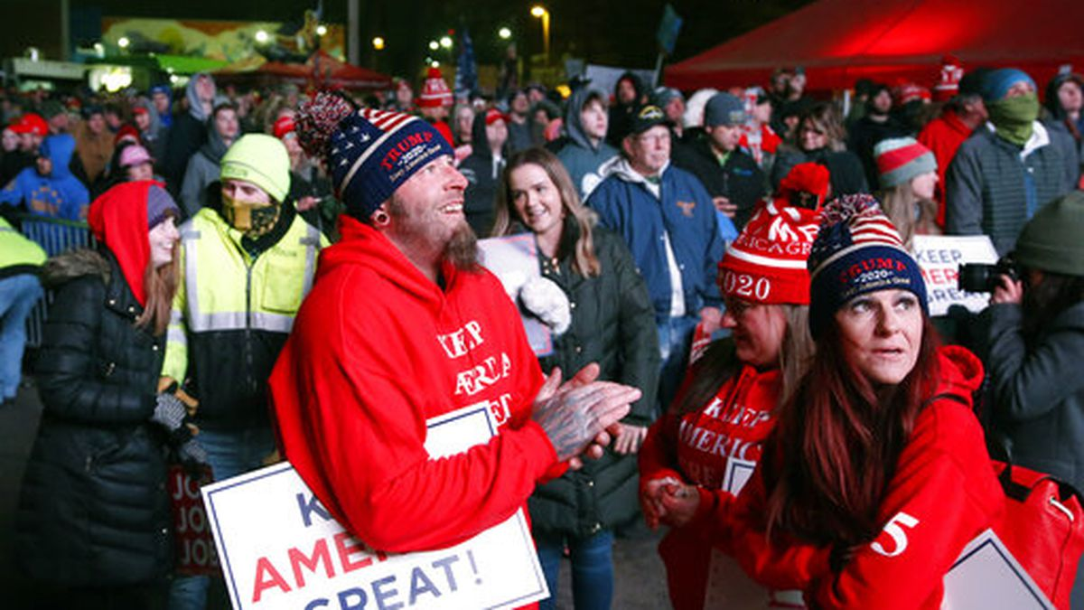Trump supporters wait the arrival of President Donald Trump as they watch a live feed outside an campaign rally for President Donald Trump, Thursday, Jan. 30, 2020, in Des Moines, Iowa. (AP Photo/Sue Ogrocki)