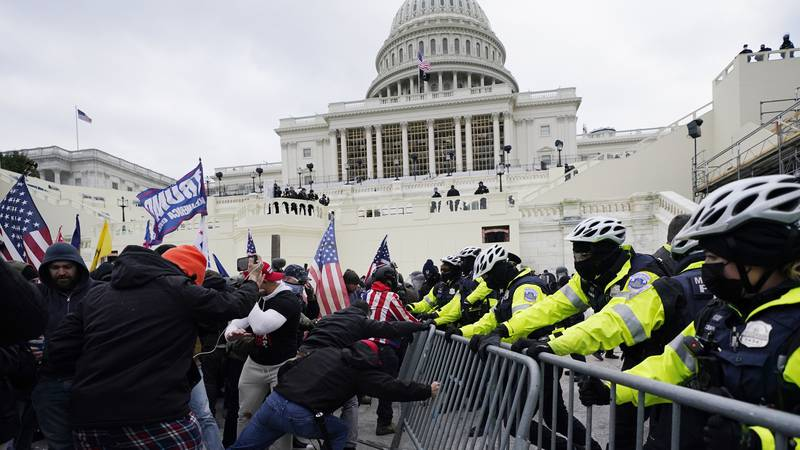 FILE - In this Jan. 6, 2021 file photo, supporters loyal to then-President Donald Trump try to...