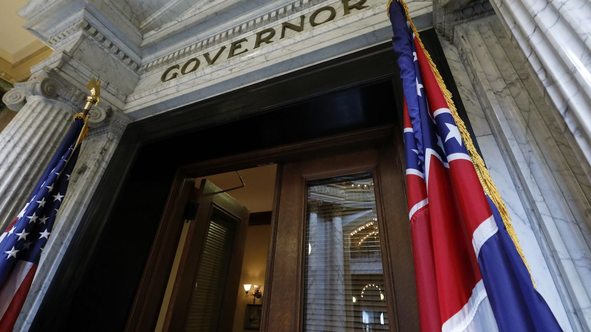 The Mississippi state flag is shown across from the American flag, outside the Governor's Office at the Capitol in Jackson, Miss., Monday, June 29, 2020, the day after both chambers of the state Legislature passed a bill to take down and replace the current flag, which contains the Confederate battle emblem. (AP Photo/Rogelio V. Solis)
