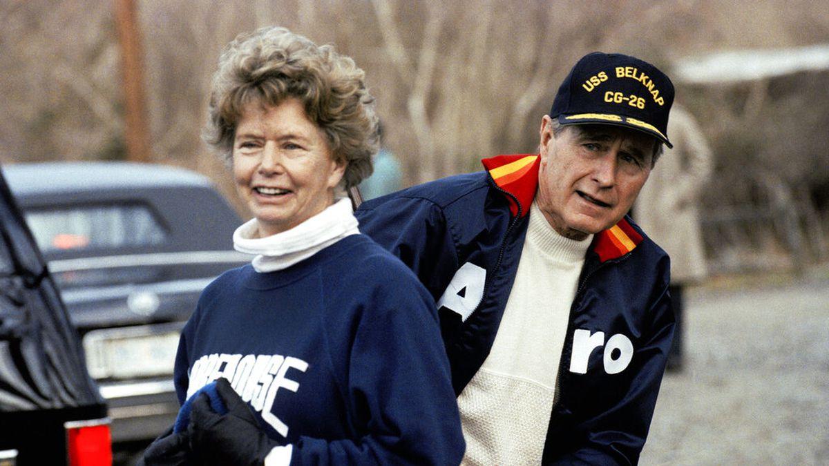 This Jan. 7, 1990, file photo shows President George H. W. Bush hiding behind his sister, Nancy...